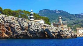 Lighthouse in Port de Soller, Majorca Mallorca, Spain. Lighthouse at the entrance to the Port de Soller, Majorca Mallorca, Spain stock photo