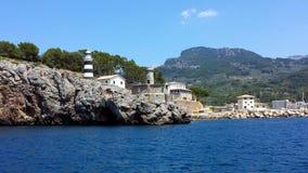 Lighthouse in Port de Soller, Majorca Mallorca, Spain. Lighthouse at the entrance to the Port de Soller, Majorca Mallorca, Spain royalty free stock image