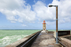 Lighthouse at the port of Fecamp Stock Images