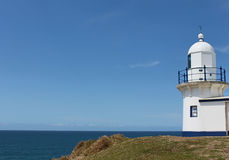Lighthouse at Port Macquarie Australia. Lighthouse against blue sky located at Port Macquarie Australia Stock Photos