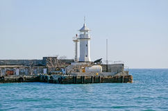 Lighthouse in the port of Yalta Royalty Free Stock Photos