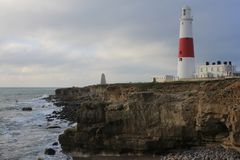 Lighthouse at Portland Bill, Dorset, UK. One of the un-manned lighthouses around the UK`s coastline. Built 1906, it warns of the hazard posed by Shambles Bank royalty free stock photo
