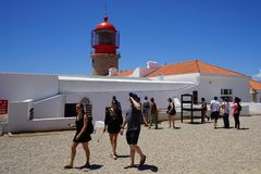 Lighthouse in Portugal. Portugal Algrave region, costa Vicentina, cape Saint Vincent, red lighthouse, tourist atraction Royalty Free Stock Photography