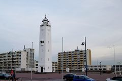 Lighthouse at the promenade of Noordwijk aan Zee in the Netherlands at the north sea coast, with a height of 33 meters or 100 Ft. Lighthouse at the promenade of royalty free stock photography