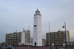 Lighthouse at the promenade of Noordwijk aan Zee in the Netherlands at the north sea coast, with a height of 33 meters or 100 Ft. Lighthouse at the promenade of royalty free stock images