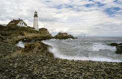 Lighthouse Protects During Storm Stock Images