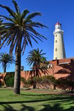 Lighthouse at Punta del este. The lighthouse of Punta del Este and a beautiful palm, Uruguay Royalty Free Stock Image