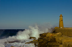 Lighthouse in the raging sea, Girne, Cyprus Royalty Free Stock Photo