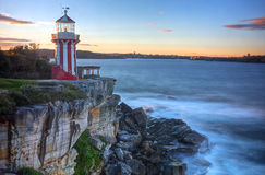 Lighthouse in red. Hornby lighthouse overlooking cliffs near Sydney Royalty Free Stock Photo