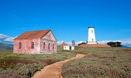 Lighthouse and red brick fog signal building at Piedras Blancas point on the Central California Coast north of San Simeon Californ Royalty Free Stock Photo