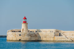 The lighthouse with red top Stock Images