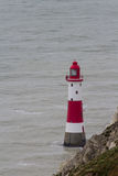 Lighthouse red and white striped on stormy winter day. Stock Photography