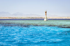 Lighthouse on reef shallows, around the salt water of the red se Royalty Free Stock Images