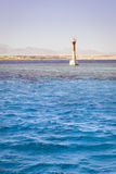 Lighthouse on reef shallows, around the salt water of the red se Stock Photography