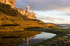 Lighthouse reflect hor Royalty Free Stock Photos