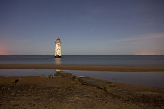 Lighthouse reflection Stock Photography