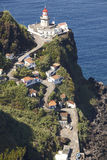 Lighthouse, road and atlantic ocean in Ponta do Arnel, Azores Stock Photo