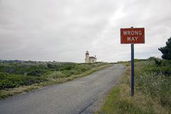 Lighthouse and road sign Royalty Free Stock Photos