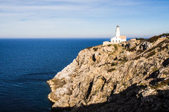 Lighthouse on the rock Royalty Free Stock Photography