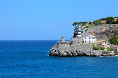 Lighthouse on the rock in Port de Soller, Mallorca Stock Photo