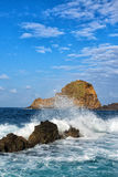 lighthouse and rock in porto moniz in madeira Stock Image