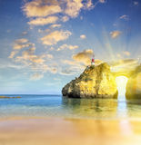 Lighthouse on the rock at the sea shore. Royalty Free Stock Photos