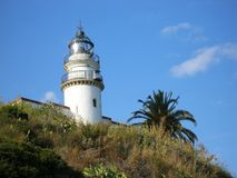 Lighthouse on a rock. Tropical beach. Stock Image