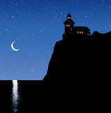 Lighthouse on a rock. Vector drawing Royalty Free Stock Image