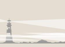 Lighthouse and Rocks Stock Image