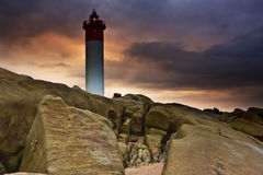 Lighthouse on Rocks Royalty Free Stock Photo