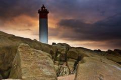 Lighthouse on Rocks. Umhlanga Lighthouse on the rocky coast of South Africa Royalty Free Stock Photo