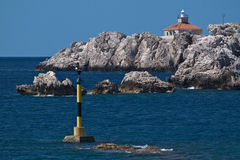 Lighthouse on the rocks, Adriatic sea, Croatia Stock Photo