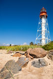 Lighthouse with rocks Stock Images