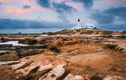 Lighthouse on the rocks Royalty Free Stock Photo