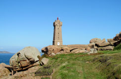 Lighthouse on the rocks royalty free stock images
