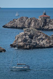 Lighthouse on the rocks, yachts. Adriatic sea Royalty Free Stock Photo