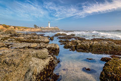 Lighthouse and rocksn in Pacific coast Stock Images