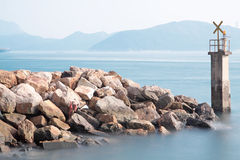 Lighthouse on a Rocky Breakwall Royalty Free Stock Photo