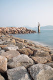 Lighthouse on a Rocky Breakwall Royalty Free Stock Photography