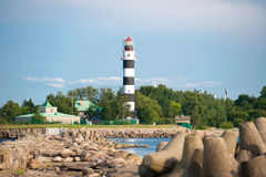 Lighthouse on rocky coast Royalty Free Stock Photo