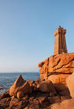 Lighthouse on a Rocky Coast royalty free stock photos