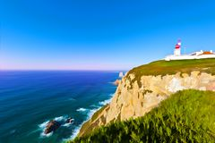 Lighthouse at Sunset. Lighthouse on the Rocky Coast of Atlantic Ocean in Cabo da Roca at Sunset, Stylized Photo vector illustration