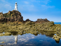 Lighthouse on the rocky coast of Jersey Island Royalty Free Stock Image