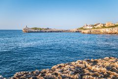 Lighthouse on the rocky coast of the Spanish island Mallorca. Lighthouse on the rocky coast of the Spanish island Mallorca, Europe Stock Image