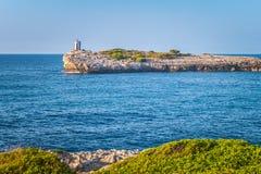 Lighthouse on the rocky coast of the Spanish island Mallorca. Lighthouse on the rocky coast of the Spanish island Mallorca, Europe Stock Photography