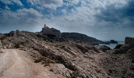 Lighthouse on a rocky Island. Lighthouse on the Frioul Archipelago near Marseille, France Royalty Free Stock Image