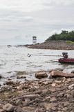 Lighthouse on the rocky island Royalty Free Stock Photo