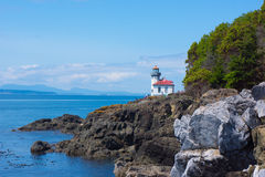 Lighthouse Lime Kiln San Juan Island. The San Juan Island light house guides ships with safe passage through the Straits of San Juan del Fuca in Washington state Royalty Free Stock Photos