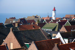 Lighthouse and roofs of an old Dutch village Stock Image