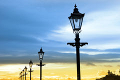 Lighthouse and row of vintage lamps. On the promenade in Youghal county Cork Ireland Stock Photos